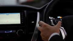 Driver use function button on steering wheel to control navigator Stock Footage
