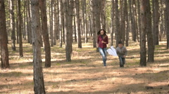 Boy running with paper airplane with her mom and laughs Stock Footage