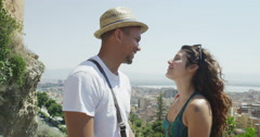 4K Romantic couple share a kiss with city view in background Stock Footage