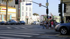 People waiting to cross the road in Hollywood Boulevard Stock Footage