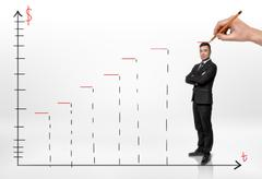 Smiled businessman standing on schedule of profit growth and someone hand Stock Photos