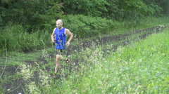 Male runner exercising and training outdoors in nature. traill-running.Rainy Stock Footage
