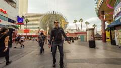 Drunk man stumbling in Las Vegas downtown, surroundings moving in reverse Stock Footage