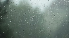 Rain pouring down the dark sky, hitting a window-backward,accelerated footage Stock Footage