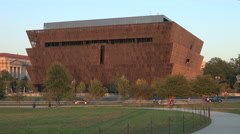 Sun setting on Museum of African American History and Culture creates warm glow Stock Footage