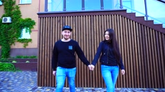 Sweetheart Female and Male go Directly at Camera and Hold Hands, Watching Each Stock Footage