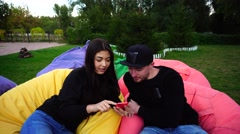 Attractive Young Loving Couple Decided Have Work or Rest and Using Smartphone Stock Footage
