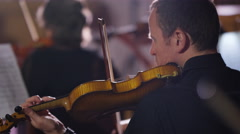 4K View from behind orchestra violinists during a performance Stock Footage