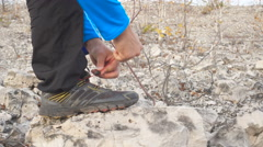 Man Runner tying his shoes on the stone. Stock Footage