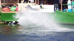 Wakeboarder performs a high long jump and flies in the air, slow motion Stock Footage