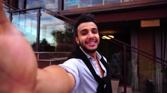 Young Arab Guy Takes Selfie With Camera Hand, Looking at Camera and Smiling on Arkistovideo