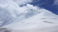 Clouds in mountains timelaps. Top of the mountain Kazbek. background Stock Footage