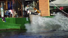 Wakeboarder jumps and turns in the rotation around its axis. Slow motion Stock Footage