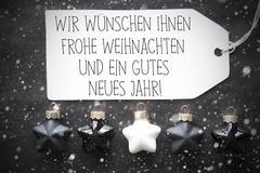 Black Christmas Balls, Snowflakes, Gutes Neues Means Happy New Year Stock Photos