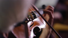 4K Close up on violin being played during orchestra performance Stock Footage