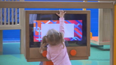 Child   play with multimedia displays and playground educative stands Stock Footage