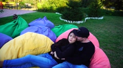 Couple in Love Hugging Each Other and Talk in Multicolored Armchairs, Smiling Stock Footage