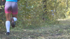 People running cross country in autumn forest. Jogging motivation in green pa Stock Footage