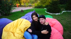 Newly Married Posing in Armchairs and Hugging Each Other, Stroking and Sitting Stock Footage