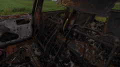 Dolly shot of Trap Car Burned After Bombing of the City Stock Footage