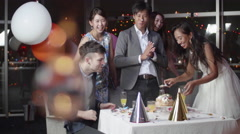 Fun International japanese friends at luxery birthday party Stock Footage