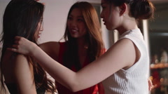 Japanese models doing hair at party  Stock Footage