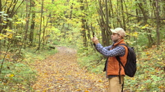 Young, Lost Man With Smartphone Looking For Direction On The Forest. Guy usin Stock Footage