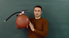 The young instructor explains the functional use of the fire extinguisher. Stock Footage