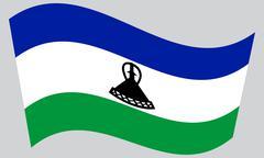 Flag of Lesotho waving on gray background Stock Illustration