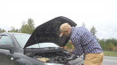 Men opens the car hood and visually inspects examines the motor engine, check Stock Footage