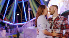 Couple Romantic Discussion on a Date at Night Under the Colored Lights Stock Footage