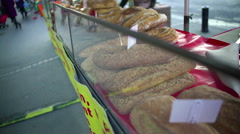 Freshly baked bread lying on the showcase at street market, crisis, high prices Stock Footage
