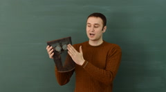 White male instructor shows the design of mask shield to protect face and eyes. Stock Footage