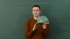 Young instructor talks about the use of safety helmet at the construction site. Stock Footage