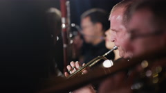 4K Symphony orchestra during a performance with focus on trumpet player Stock Footage
