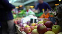 Man buying fruit at local market, healthy lifestyle and food, view on apples Stock Footage