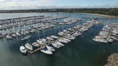Forward flight over Sandringham Marina and rising high revealing surroundings Stock Footage