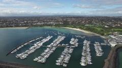 Backwards flight away from Sandringham marina passing sailboats Stock Footage