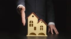 Businessman give handshake over a house model on a table Stock Footage