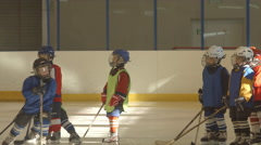Little hockey players stand on an ice Stock Footage