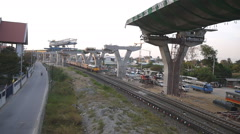 Train running under express way construction site Stock Footage