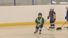 Little hockey player stand and start to do an exercise Stock Footage