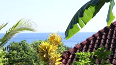Tropical lagoon with clear water and buildings in forest on a hillside. Amed Stock Footage