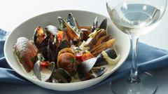 Mussels with wine, tomato and onion sauce Stock Photos