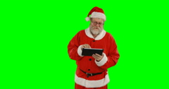 Santa claus using digital tablet Stock Footage