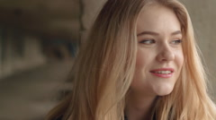 Beautiful blonde young girl fashion look smiling and talking close-up Stock Footage