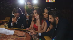 Elegant man and woman gambling at the casino. friends playing blackjack Stock Footage