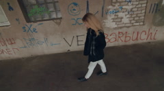 Beautiful blonde young girl fashion look walking at the old building Stock Footage