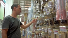 Man is shopping at hardware store Stock Footage