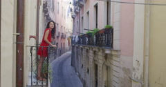 4K Happy couple in hotel or apartment go out onto balcony to look at the view Stock Footage